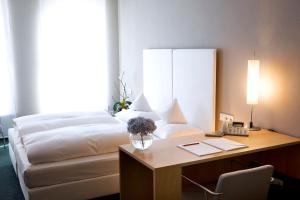 Ein Bett oder Betten in einem Zimmer der Unterkunft Hotel an der Stadtmauer