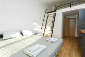Voodi või voodid majutusasutuse OldTown Tartu Apartments toas
