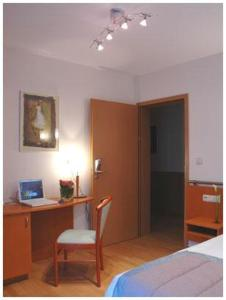 A bed or beds in a room at Hotel South Charleroi Airport