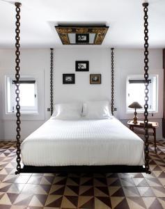 Cama o camas de una habitación en Hospedería Diez Y Seis