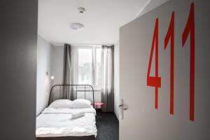 Posteľ alebo postele v izbe v ubytovaní NH Hostel