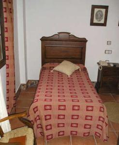 Кровать или кровати в номере El Perro de Paterna