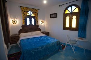 Un ou plusieurs lits dans un hébergement de l'établissement Dar Swiar