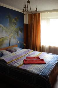 A bed or beds in a room at Guest House on Krasnoslobodskaya