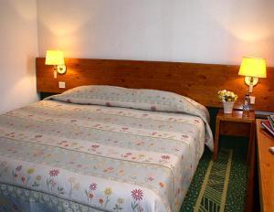 Un ou plusieurs lits dans un hébergement de l'établissement Alpha