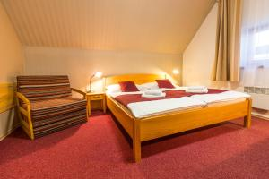 A bed or beds in a room at Hotel Kravi Hora