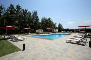 The swimming pool at or near Mas la Casassa