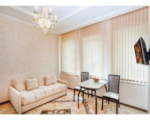 Гостиная зона в Apart-hotel Lenina 57