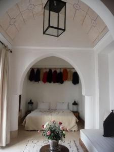 Un ou plusieurs lits dans un hébergement de l'établissement Riad Matham