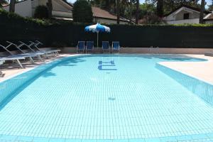 Bazén v ubytování Hotel Carlton nebo v jeho okolí