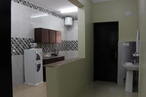 مطبخ أو مطبخ صغير في ريانة أبها للشقق المفروشة