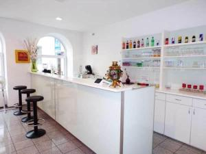 A kitchen or kitchenette at Hotel City Residence