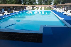 The swimming pool at or near Atlantic Inn and Suites - Wall Township