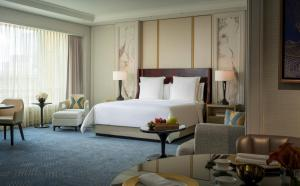 A bed or beds in a room at Four Seasons Hotel Macao, Cotai Strip