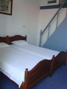 A bed or beds in a room at Horio Village Rooms