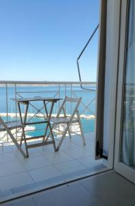 A balcony or terrace at 12 Gods Resort