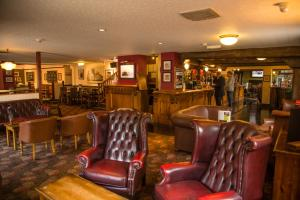 The lounge or bar area at The Twelve Knights