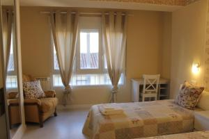 Cama o camas de una habitación en Disfruta León a pie