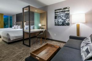 A bed or beds in a room at SpringHill Suites by Marriott Jackson Hole