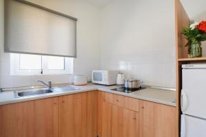 A kitchen or kitchenette at Matina Pefkos Aparthotel