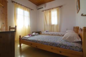 A bed or beds in a room at Country Side Apartments