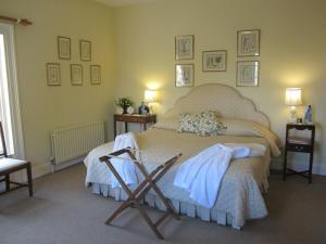 A bed or beds in a room at Ballymote Country House
