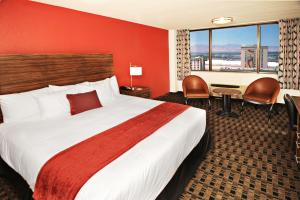 A bed or beds in a room at The D Las Vegas