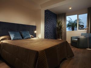 Cama o camas de una habitación en Livescape Soriano Suites