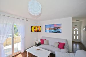 A bed or beds in a room at Villa CasaBlanca