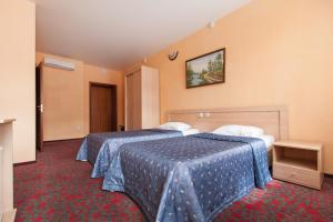 Кровать или кровати в номере Отель Регина Баумана