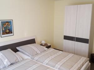 Ein Bett oder Betten in einem Zimmer der Unterkunft Hotel Restaurant Gunsetal
