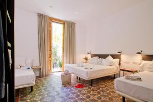 Cama o camas de una habitación en Som Nit Triomf