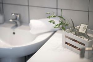 A bathroom at Olive Tree Apartments