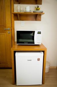 A kitchen or kitchenette at Morada Bem Me Quer