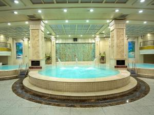 The swimming pool at or near Osotto Recreation Hotel Baiyun