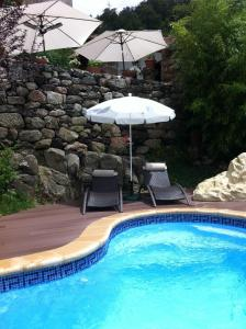 The swimming pool at or near O Remanso Dos Patos