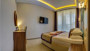 A bed or beds in a room at Hotel Complex Novyi Svet