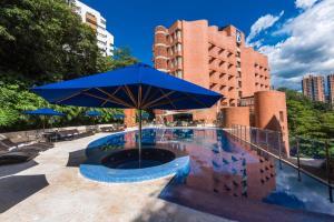 The swimming pool at or near Hotel Dann Carlton Belfort Medellin