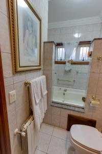 Um banheiro em Hotel Pousada Florença