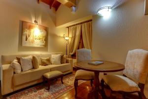 Uma área de estar em Hotel Pousada Florença