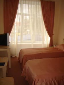 A bed or beds in a room at Black Sea Rozdil'na