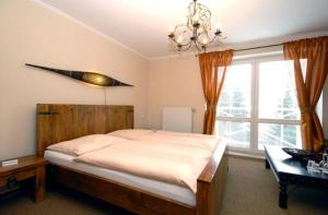 A bed or beds in a room at Penzion Bystrica