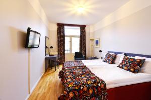 Säng eller sängar i ett rum på Svea, Sure Hotel Collection by Best Western