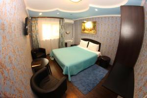 Кровать или кровати в номере Отель Фортуна