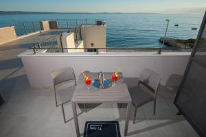 A balcony or terrace at Seaside Luxury Suites