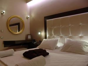 A bed or beds in a room at Ellinis Hotel