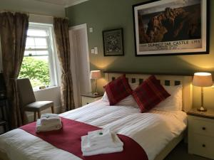 A bed or beds in a room at Arduthie House