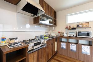 A kitchen or kitchenette at Maisan-chi Guesthouse & Cafe