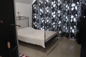 Кровать или кровати в номере Apartments on Ulitsa Tenistaya