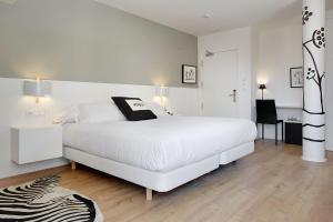 Cama o camas de una habitación en Hotel Flysch